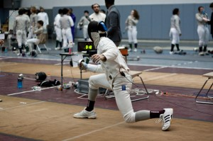 Bobby Maiocco '15 lunges forward with balance and poise during a fencing match on Saturday, February 2. The men's team came away with several against Yale, Drew and Hunter Universities. By: Katie de Heras