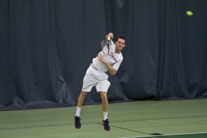 Andrew Guzick '13 serves the ball to his opponent at last week's match against Clark University. Last year, Guzick's skill in doubles earned him and his partner a spot in the All-American champinships Photo By: Spencer Davis