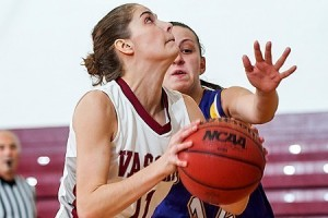 Forward Natalie Allen '13 takes a shot in a close home game against R.I.T., which ended with an 85-75 victory for the Brewers. The unexpected win set a new record for most wins in school history. Photo By: VC Athletics