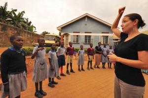 Howlett, working with the Ashinaga Foundation, teaches music to students at the Ashinaga Uganda Rainbow House. Howlett and several Ford Scholars spent time in Uganda during her sabbatical. Photo By: Shinji Shinoda