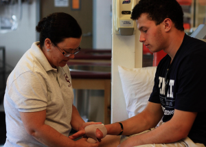 """Susan """"Suzi"""" Higgins, the newly appointed Head Athletic Trainer, handles student-athletes health care. Higgins has been a certified member of the National Athletic Trainer's Association since 1992. Photo credit: Angelo Roman."""