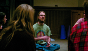 Gabe Dunsmith '15, an intern for Religious and Spiritual Life, leads Soul Sunday in the Library Quiet Room. Students learn contemplative practices in this relaxing environment. Photo By: Cassady Bergevin