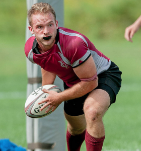 Senior Karl Foley strives for a win alongside of the rest of the men's rugby team. This year they have advanced to the Final Four. Courtesy of: Vassar Athletics.