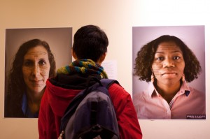 The Privilege Campaign features images of faculty and administrators dsiplaying accounts of their privileges across their faces. The show is open to all and is located in the faculty commons. Photo By: Sam Pianello