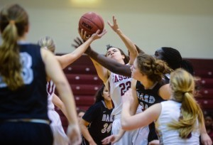 Sophomore women's basketball player Rose Serafina goes for a rebound in the middle of a match against Bard College on Jan. 21 last week. The Brewers won the match with 79 points with Bard at 61. Photo by: Spencer Davis