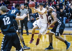 Men's Basketball player and senior Evan Carberry takes the ball to the hoop to score a crucial point for the Brewers against Bard College. Vassar won the games with 66 points compared to Bard's 59. Photo By: Jacob Gorski