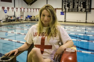 Kayla Schwab '17 stands watch over Vassar's Kresage Pool. A work study job available through student employment, the position is open only to individuals with CPR and lifeguard certification. Photo By: Alec Ferretti
