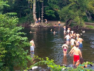 Swinging off the Tarzan Tree's rope swing at the Watering Hole, a wooded oasis 30 minutes away from Vassar, is a great way to spend a warm weekend afternoon in September with friends. Photo By: Vassar Outing Club