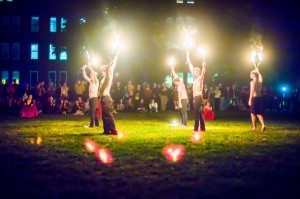 The Barefoot Monkeys' juggle torches at their annual Fire Show held on the Residential Quad last Friday evening. A lot of attention has been paid to the safety of the show, due to the open flames. Photo By: Alec Ferretti