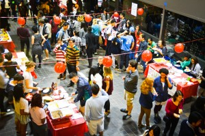 Long strings of red paper lanterns hung throughout the College Center as students from various orgs sell food they have cooked during the ASA's annual Asian Night Market event this past Saturday. Photo By: Emily Lavieri-Scull