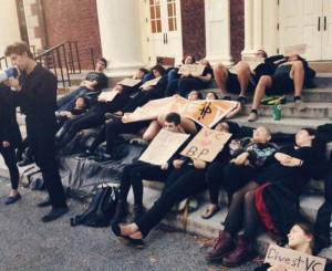 Members of the Vassar Divestment Campaign lie on the steps of the ACDC as they partake in an Oil Spill event. The oil spills are part of a greater initiative to raise awareness towards divestment. Photo By: Vassar Greens