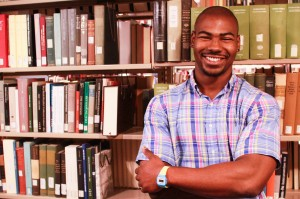 Osamagbe Ogbeide '15 is organizing a book drive on campus to help provide books for new Ugandan reading centers. The reading centers will help establish a Ugandan reading culture and aid the development of intellectualism. Photo By: Jacob Gorski