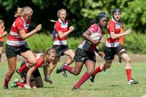 Junior center Cierra Thomas breaks through the defensive line of a recent opponent. Her strong running and aggressive tackling skills helped a successful women's rugby team reach the quarterfinals. Photo By: Vassar Athletics