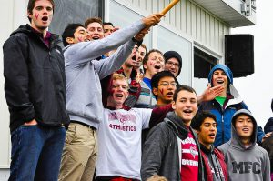 Men's soccer fans, led by Josh Pratt, work to bring the intensity of diehard English premier league fans to Vassar. The group, pictured above, come up with chants for each player to amp up Brewer pride. Photo By: Vassar Athletic Communications