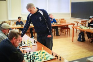 Top-ranked chess master William Fisher plays a simul, where he plays several chess games against different opponents at one time. Fisher came up from the city to celebrate National Chess Day with Vassar's chess club. Photo By: Jacob Gorski