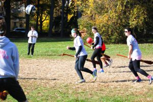 Vassar's Quidditch team, known as the Butterbeer Brewers, do not have a designated facility, but they are often seen practicing on Joss Beach. This semester, they hosted the Butterbeer Classic, placing second. Photo By: Vassar Quidditch