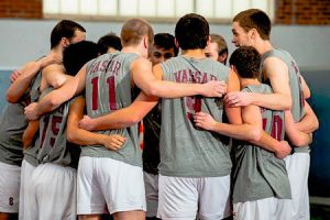 The Brewers huddle together as they look to their coach and one another for inspiration in the upcoming game. The men look forward to a strong, successful spring season. Photo By: Vassar College Athletics