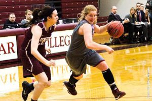 Junior guard Caitlin Drakely drives to the hoop with force. Drakely has maintained her stellar play as of late, winning herself a spot on the Liberty League honor roll as she helped the women to victory. Photo By: Vassar College Athletics