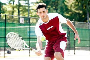 Junior tennis player Evan Udine concentrates fiercely as he winds up for a forhand. Udine has made the most of his opportunities this season, seeing significant time as a starter and making an impact. Photo By: Vassar College Athletics