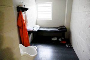 """Pictured above is a cell in the Dutchess County Jail. These cells exist beyond """"The Door""""— the division between freedom and imprisonment. The jail has a population of 500 inmates. Photo By: The Poughkeepsie Journal"""