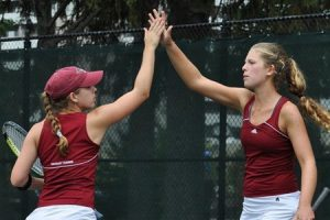 Sophomore Hanna McGuire and freshman Courtney Geiss high five after a particularly gruelling point. The duo are just a few of the women's young core that looks to make an impact this season. Photo By: Vassar College Athletics