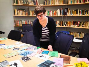Pictured above, Head of Acquisitions and Cataloging Services Heidy Berthoud arranges some of the library's newly acquired zines. So far, she has accrued over a hundred zines, which currently live in her office. Photo By:  Marie Solis
