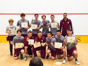 Men's squash poses for a victory photo after their thrilling championship match against Bard College. This is Vassar's first ever division title. The men look to carry this success into next season. Photo By: Vincent Mencotti