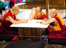 Dr. Hun Lye, Lama Somar and Khenpo Choepheo are three lamas who are creating a sand mandala in the Villard Room throughout the week. Once they finish the mandala, they will sweep up the sand and pour it into Sunset Lake, as per tradition. Photo By: Emily Lavieri-Scull