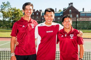Coach Alex Wong and Assistant Coach Nick Jasso stand with junior William Zhu in front of the Joss tennis courts. The Men's Tennis team are headed to the Liberty League Championships this weekend. Photo By: Vassar Athletics