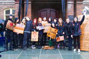 """Members of DivestVC organized another """"Human Oil Spill"""" protest during Admitted Students Weekend on Sunday, April 12, demanding that the College divest its interests from fossil fuel companies. Photo By: Vassar Greens"""