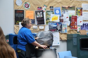A member of the custodial staff empties the trash in the Retreat. Many members of Vassar's custodial staff have worked here for years and enjoy interacting with students on a regular basis. Photo by Joshua Sherman