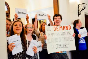 Students protested inside Taylor Hall to persuade trustees to divest from energy companies that capitalize on the burning of fossil fuels while also seeking a referendum on the issue. Courtesy of Divest Vassar