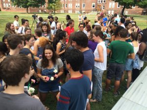 First-year students and seniors mingle on the residential quad after the Sept. 10 Serenading event. This year, seniors gave the first-years flowers in Vassar colors to thank them for their songs. Courtesy of Karen Crook