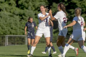 Senior Rory Chipman celebrates with teammates sophomore Audrey Pillsbury and senior captain Emily Krebs after a goal. The women bested league opponent Skidmore 7-1 on Saturday, Sept. 24. Photo courtesy of Carlisle Stockton
