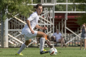 Junior Alex Gonzales looks towards teammates in game against University of Rochester. Gonzales was crucial for Brewers' recent success with a game-winning goal against RIT. Photo courtesy of Carlisle Stockton