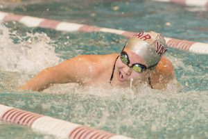 Senior captain Julia Cunningham (above) races in a butterfly competition last year. She and the Vassar swim teams will start the 2016-17 season on Oct. 26 at Bark College. Photo courtesy of Carlisle Stockton