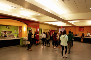 Students wait in line for their meal at the All Campus Dining Center. If the ongoing renovations continue according to plan, the interior of the building will be transformed into a more open, inviting space. Photo courtesy of Laurel Hennen Vigil