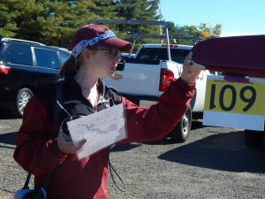 Junior Millie Cunningham helps the team prepare for its Head of the Fish race. With a strong showing, Vassar rowing has completed a successful fall and will resume competition in Spring 2017.  Courtesy of Carlisle Stockton
