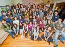 Students attending and organizing the Thanksgiving dinner hosted at the Meade family's home pose together for a photo in the midst of the festivities. Photo courtesy of Vassar College/ Karl Rabe
