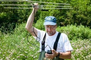 Professor Pregnall uses a transmitter to track Blanding's Turtles during the Undergraduate Research Summer Institute (URSI) circa 2013. His project focused on protecting turtle nests from predators. Courtesy of Vassar Alumnae/i Quarterly