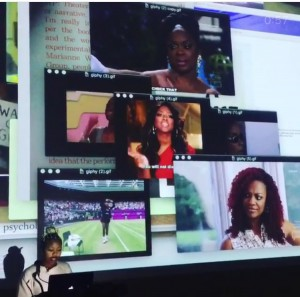 During her talk, contemporary artist Martine Syms overlayed GIFs and text from her computer to demonstrate to the audience how she approaches her subjects, which include race and identity. Photo courtesy of Sam O'Keefe