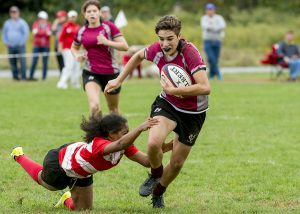 Sohomore Rachel Elson breaks away from Marist opponent to help the Brewers clench the 38-5 win. Women's rugby will next play on Saturday, Nov. 12 against SUNY Geneseo. Photo courtesy of Carlisle Stockton
