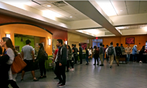 Crowds of students mill about the All Campus Dining Center during the dinnertime rush hour. Food service workers struggle to manage the sporadic nature of part-time employment. Photo by Andrea Wang/The Miscellany News