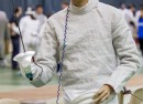 Junior Eric Lee prepares for match during the Matt Lampell Hudson River Invitational. With undefeated record, the fencing team next competes in Sacred Heart Multi-Meet on Dec. 4. Courtesy of Carlisle Stockton
