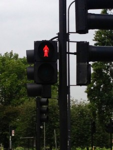 "Unlike in the U.S. the red pedestrian signal ranges in meaning, from ""stop"" to ""I'm not going to change to green for the next five minutes, so you might as well cross since all the cars stopped"" to ""You feeling lucky, punk?"""