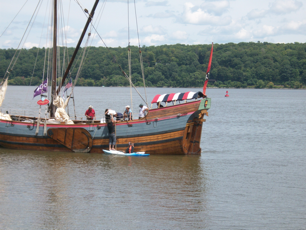 Lunch time!  Pizza delivered by kayak, to the Dutch replica sloop Onrust near Saugerties NY.
