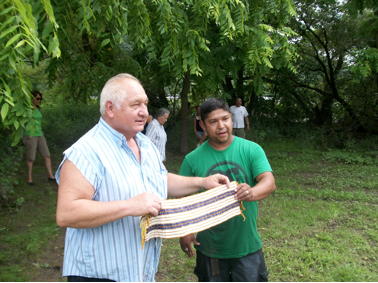 Tom Porter, Mohawk elder, and Hickory Edwards, Onondaga lead paddler, with the Two Row Wampum.
